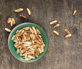 Pine Nuts In Green Bowl Stock Photos - 43959783