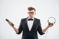DJ In Tuxedo Holding Microphone And Headphones Stock Photography - 43965422