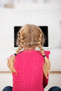 Little Girl With Pigtails Looking At Laptop Royalty Free Stock Images - 43965679