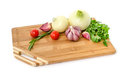 Raw Vegetables On Cutting Board On White Background Stock Images - 43972864