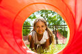 Black Beautiful Girl Crawling Though The Tube Stock Images - 43980944