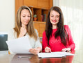Happy Girls Work With Documents Stock Photo - 43999510