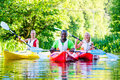 Friends Paddling With Canoe On River Stock Photo - 44002750