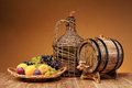 Wicker Wine Bottle, Grapes And Wooden Barrel Royalty Free Stock Photos - 44017548