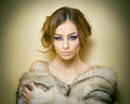 Attractive Sexy Young Woman Wearing A Fur Coat Posing Provocatively Indoor. Portrait Of Sensual Female With Creative Haircut Royalty Free Stock Image - 44026866