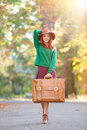 Girl With Suitcase Royalty Free Stock Images - 44029099