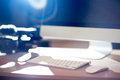 Video Editing Workstation With Video Camera Beside Royalty Free Stock Image - 44039196