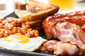 Full English Breakfast With Bacon, Sausage, Egg, Baked Beans And Orange Juice Stock Image - 44067921