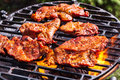 Grilling Pork Steaks On Barbecue Grill Stock Image - 44068501