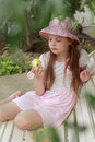 Little Girl Eating Green Apple Royalty Free Stock Images - 44076989