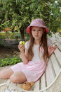 Little Girl Eating Green Apple Stock Image - 44077001