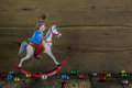 Old Christmas Decoration Of Tin: Rocking Horse On Wooden Backgro Stock Photos - 44098803