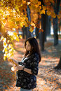 Pregnant Woman Hold Tree Branch In Park Royalty Free Stock Photo - 4417095