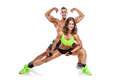 Beautiful Young Sporty Couple Posing And Showing Muscle Royalty Free Stock Photography - 44120947