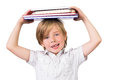 Student Balancing Books On His Head Royalty Free Stock Images - 44136779