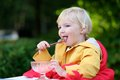 Cute Toddler Girl Eating Ice Cream Outdoors In Cafe Stock Photography - 44140212