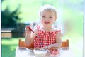 Happy Small Child Eating Yogurt With Strawberries Stock Photography - 44141412