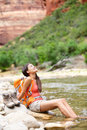 Relaxing Hiker Woman Resting Feet In River Hiking Stock Photos - 44158443