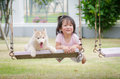 Asian Baby  Baby On Swing With Puppy Stock Photo - 44161640