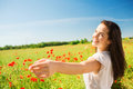 Smiling Young Woman On Poppy Field Stock Photo - 44168240