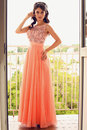 Beautiful Woman With Dark Hair In Coral Dress Posing On Balcony Stock Image - 44174921