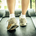 Woman S Muscular Legs On Treadmill Stock Photography - 44184052