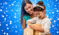 Happy Mother And Child Girl With Gift Box Royalty Free Stock Image - 44202816