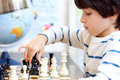 Boy Playing A Game Of Chess Royalty Free Stock Photos - 44213438