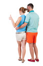 Young Couple Pointing At Wal Back View Stock Image - 44216521