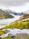 First Snow In Alps Touristic Region. Fresh Green Meadow With Rapids Stream. Peaks Of Alps Mountains In Background. Royalty Free Stock Photos - 44272758