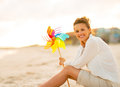 Young Woman With Colorful Windmill Toy Stock Photos - 44274303