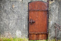 Rusted Metal Door In Old Wall, Background Texture Royalty Free Stock Image - 44290116