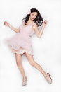Young Brunette Beautiful Woman Dancing In Pink Dress Isolated Over White Background Stock Images - 44291194