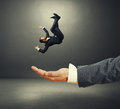 Palm Catching Small Startled Businessman Royalty Free Stock Image - 44296536