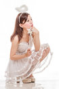 Beautiful Asian Woman In Angel Costume, Sitting Looking Up Royalty Free Stock Photography - 44310157
