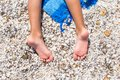 Closeup Of Little Girl Legs On Tropical Beach With Royalty Free Stock Photo - 44334715
