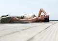 Young Woman Lying Down And Laughing Outdoors Royalty Free Stock Photography - 44356857
