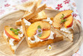 Toast With Cottage Cheese, Raisins And Fresh Ripe Peaches Royalty Free Stock Photos - 44383188
