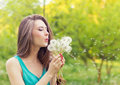 Beautiful Happy Smiling Girl With Long Dandelions In The Hands Of Shorts And A T-shirt Is Resting In The Park On A Sunny Day Royalty Free Stock Photo - 44383285