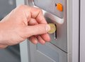Human Hand Inserting Coin In Vending Machine Stock Image - 44397311