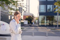 Young Woman Chatting On Her Mobile Phone Royalty Free Stock Image - 44403786