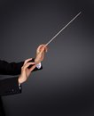 Music Conductor With A Baton Royalty Free Stock Photos - 44409638