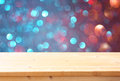 Image Of Front Rustic Table And Colorfull Bokeh Lights Background Royalty Free Stock Photos - 44411988