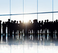Silhouettes Of Business People In An Office Building Stock Photos - 44412363