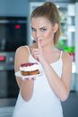 Guilty Young Woman Preparing To Eat A Cake Stock Photography - 44417622