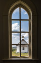 View From Inside Church Window Looking Out To Another Church Royalty Free Stock Images - 44444479