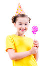 Happy Girl In Party Hat Holding Colored Candy. Stock Photos - 44458913