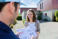 Delivery Man Handing Over A Registered Letter Stock Image - 44461841