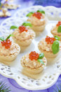 Tartlets With Seafood Salad, Red Caviar And Basil Royalty Free Stock Photography - 44464577