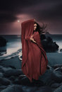 Beautiful Mysterious Woman In Long Dress At Ocean Beach. Fantasy Woman. Water Goddess. Book Cover. Royalty Free Stock Image - 44472616